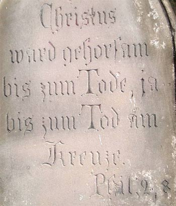 'Inscription on stone cross in, Rhineland, Germany'