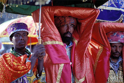'A priest of Ethiopian Orthodox Church is holding a Tabot in a Timket (Epiphany) ceremony at Gondar, Ethiopia', 2002, Jialiang Gao