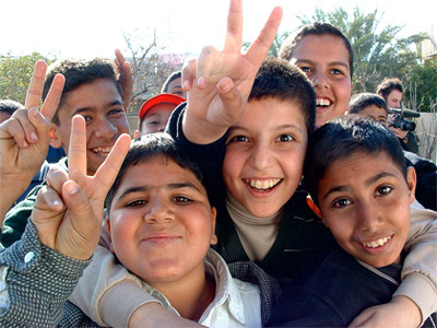 'Iraqi boys giving peace sign', 2003, Christiaan Briggs