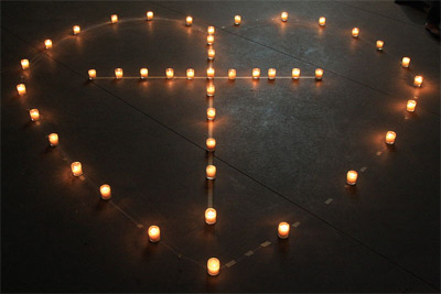 'A cross in a heart formed with candles', 2010, Wingchi Poon