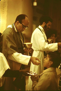 Rev. George. H. Clements giving Holy Communion, Chicago, 1973