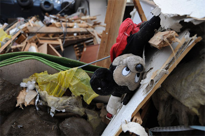 'A Mickey Mouse doll lies among debris in Ofunato', 2011