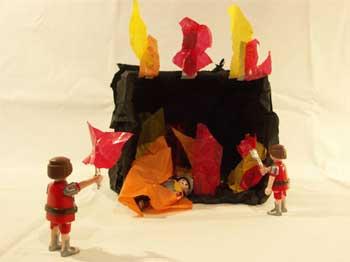 Die Diener des Königs eizen den Feuerofen an.